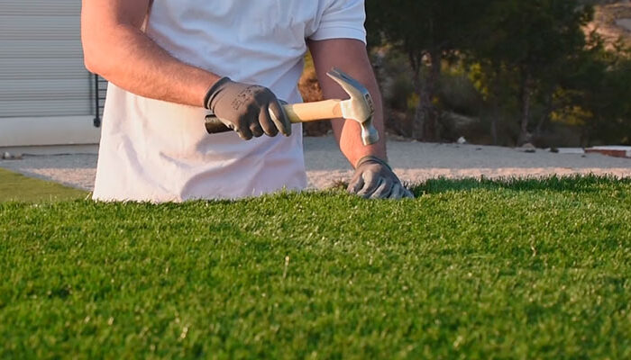 Secure edges of artificial turf