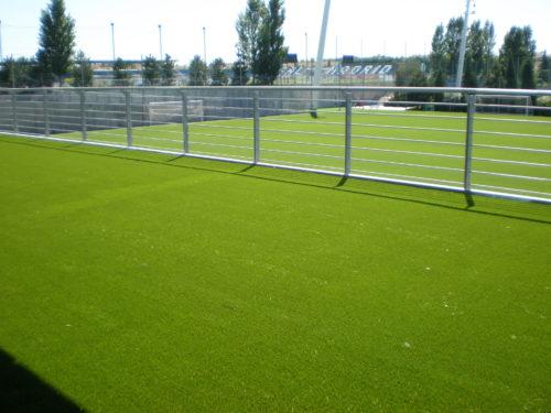 Instalación de césped artificial en las zonas comunes de la Ciudad Deportiva del Real Madrid C.F. en Valdebebas