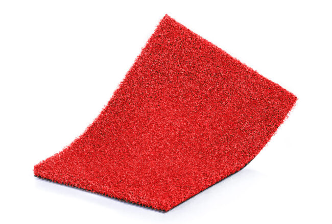Césped artificial Gymsport red, ideal para zonas deportivas.