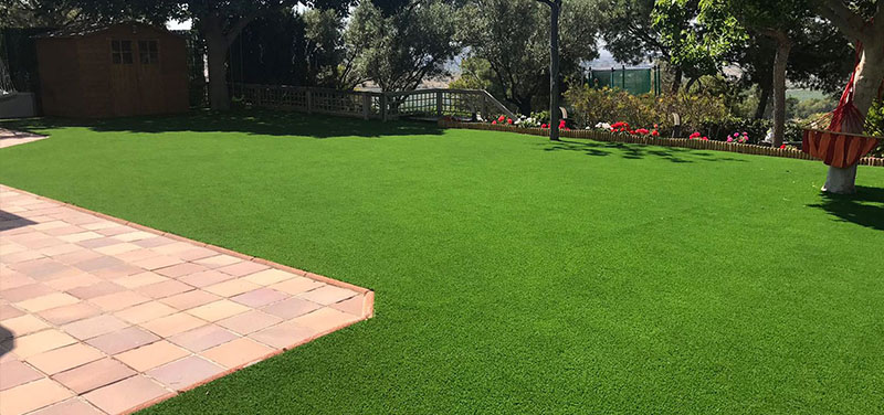 What are the advantages of artificial turf over natural turf?