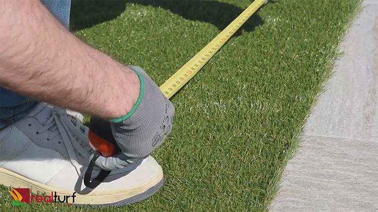 medir el césped artificial